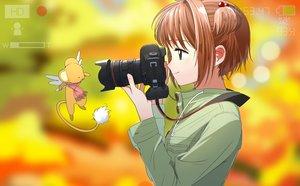 Rating: Safe Score: 70 Tags: aspara brown_hair camera card_captor_sakura kero kinomoto_sakura short_hair User: RyuZU