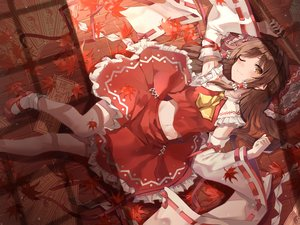 Rating: Safe Score: 42 Tags: autumn blush brown_eyes brown_hair hakurei_reimu japanese_clothes kerno leaves long_hair miko navel ofuda socks touhou wink User: mattiasc02