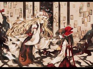 Rating: Safe Score: 99 Tags: 2girls blonde_hair bow brown_hair hakurei_reimu hat hina_(pico) japanese_clothes long_hair miko red_eyes ribbons touhou yakumo_yukari User: ガラス